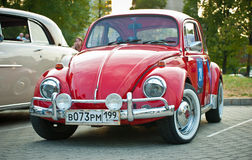 Volkswagen Beetle Red. MOSCOW - JULY 31: Volkswagen Beetle on exhibition parking at an annual event the VI race of vintage cars 'Night Moscow Classic Rally' Stock Photos