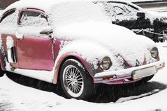 Volkswagen Beetle in the snow royalty free stock images