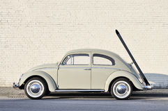 Volkswagen Beetle vintage car parked in a street. royalty free stock image