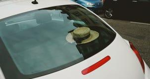 Volkswagen Beetle with woman hat inside stock video footage