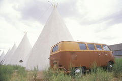 Volkswagen Bus parked next to receding teepees in NM royalty free stock photos