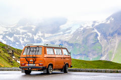 Volkswagen Caravelle. TYROL, AUSTRIA - JULY 29, 2014: Blue classic van Volkswagen Caravelle at the parking near the high Alpine mountain road Stock Images