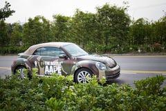 Volkswagen de nieuwe kever 2013 met AAPE-lichaam Stock Afbeelding
