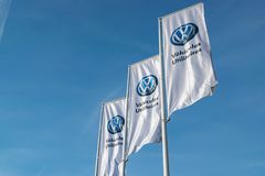 Volkswagen flags logo in the commercial vehicle showroom. Lomme,FRANCE-February 17,2019:Volkswagen is a German car manufacturing company since 1937.One of the stock photos