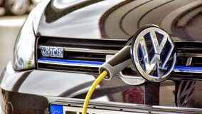 Volkswagen Golf GTE is charged at a charging station