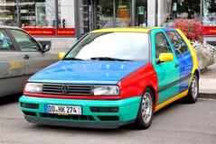 Volkswagen Golf Harlekin. DRESDEN, GERMANY - JULY 20, 2014: Funny retro car Volkswagen Golf Harlekin at the city street Stock Images