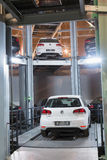The Volkswagen Golf on lift in tower for store cars Royalty Free Stock Photography