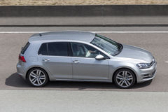 Volkswagen Golf on the road Stock Photography