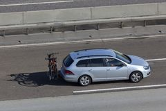 Volkswagen Golf Variant on the road. Frankfurt, Germany - Sep 19, 2017: Volkswagen Golf Variant with bicycles mounted on the tow-bar driving on the highway in Royalty Free Stock Photo