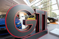 Volkswagen GTI Logo in Show room Stock Images