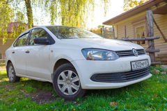 Volkswagen Jetta parked near the country house. Stock Photography