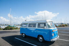 Volkswagen Kombi. Retro blue and white Volkswagen Kombi van parked at marina, Tauranga, New Zealand Royalty Free Stock Photo