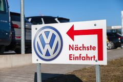 Volkswagen logo near a car dealer. FUERTH / GERMANY - FEBRUARY 25, 2018: Volkswagen logo near a car dealer. Naechste Einfahrt means next entry. Volkswagen is a Royalty Free Stock Photography