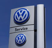 Volkswagen logo. The Volkswagen logo on a sign at a car dealer garage Royalty Free Stock Image