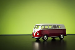 Volkswagen Microbus. Izmir, Turkey - July 23, 2015. Volkswagen microbus toy car on a green background royalty free stock image