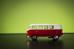 Volkswagen Microbus. Izmir, Turkey - July 23, 2015. Volkswagen microbus toy car on a green background stock photos