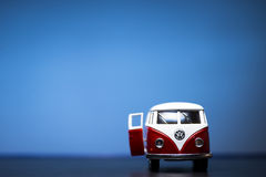 Volkswagen Microbus. Red Toy Volkswagen Microbus Van. Door is open. Front view and blue background. December 04 2014 Izmir Turkey. Volkswagen is a German stock image