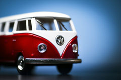 Volkswagen Microbus. Red Toy Volkswagen Microbus Van front view and blue background. December 04 2014 Izmir Turkey. Volkswagen is a German automobile stock photos