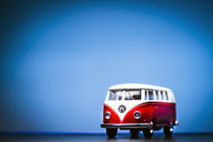 Volkswagen Microbus. Red Toy Volkswagen Microbus Van front view and blue background. December 04 2014 Izmir Turkey. Volkswagen is a German automobile royalty free stock images