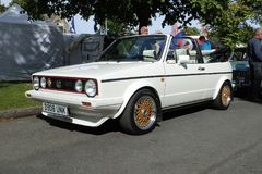 VW MK1 Golf Cabriolet GTI 1.8lt in Alpine white. Volkswagen Golf MK1 Cabriolet convertible GTI 1.8lt in Alpine white, built in 1986. BBS RS two piece alloys royalty free stock photography