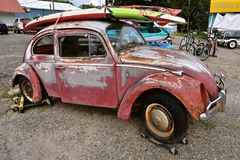 Volkswagen with paddle board on roof Royalty Free Stock Photo