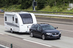 Volkswagen Passat towing a caravan Royalty Free Stock Images