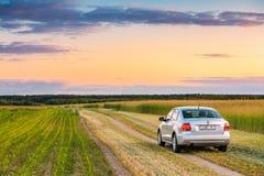 Volkswagen Polo Car Parking On Wheat Field. Sunset Sunrise Drama Stock Image