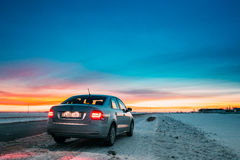 Volkswagen Polo Car Sedan Parking On A Roadside Of Country Road Stock Photo