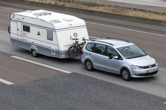 Volkswagen Sharan with a caravan Royalty Free Stock Images