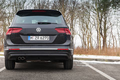 Volkswagen Tiguan, 4x4 R-Line, back side. Hamburg, Germany - February 10, 2017: Outdoor photo of second generation Volkswagen Tiguan, 4x4 R-Line. Black compact Royalty Free Stock Images