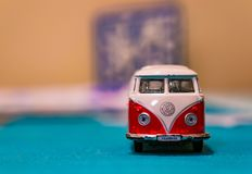 Volkswagen Van Samba toy bus. Front of a Volkswagen Van Samba toy bus with logo on a table in soft focus on circa January 2018 in Poznan, Poland Royalty Free Stock Photography