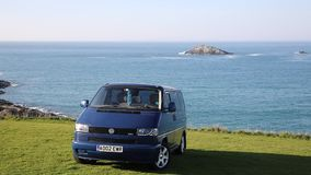 Volkswagen VW T4 Transporter Multivan in india blue with alloy wheels a garland and devil eye lights in stock video