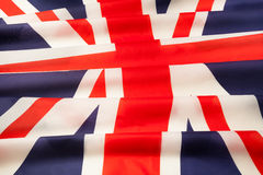 Voll gestaltete seidige gefaltete Flagge von Großbritannien Lizenzfreies Stockbild