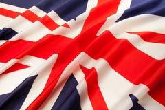 Voll gestaltete wellenartig bewegende Staatsflagge von Großbritannien Lizenzfreies Stockfoto