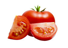 Voll u. geschnittene Tomate Lizenzfreie Stockfotografie