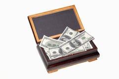 Voll vom alten Kasten des Geldes Stockfotos