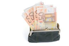 Volle Geldbörse auf einem weißen Hintergrund Stockfotos