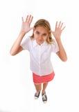 Volledig geïsoleerd het lichaamsportret die van de pret hoog hoek van tiener een grappig gezicht maken, Stock Foto