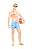 Volledig lengteportret die van een geschikte mens in zwemmende borrels, a houden Stock Foto's