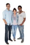 Volledig lengteportret van drie gelukkige jongeren Stock Foto