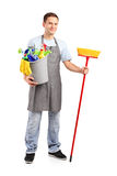 Volledig lengteportret van een glimlachende reinigingsmachine Stock Foto