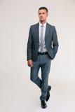 Volledig lengteportret van een knappe zakenman stock foto's