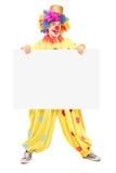 Volledig lengteportret van een mannelijke clown met gelukkige blije expressio Stock Foto's