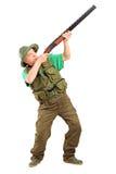 Volledig lengteportret van een mannelijke jager die met een jachtgeweer ontspruiten Stock Foto