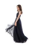 Volledig lengteportret van jonge mooie vrouw in zwarte avond D stock afbeeldingen
