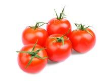 Volledig - mening van een broeikas serre-gekweekte tomaten, op een witte achtergrond Heel wat organische, verse, rode tomaten Stock Afbeelding