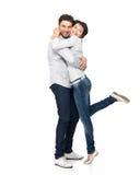 Volledig portret van gelukkig die paar op wit wordt geïsoleerd Royalty-vrije Stock Afbeelding