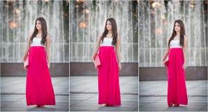 Volledige lengte van jong Kaukasisch wijfje met lange rode rok die zich dichtbij fontein bevinden Royalty-vrije Stock Foto's
