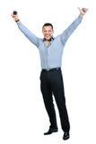 Voller Körper des glücklichen gestikulierenden jungen lächelnden Geschäftsmannes Lizenzfreies Stockfoto