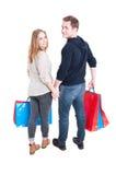 Voller Körper von den Paaren, die Bündel Einkaufstaschen halten Lizenzfreie Stockbilder